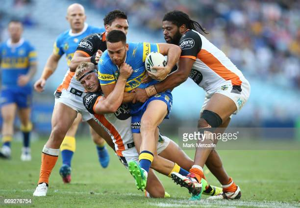 Corey Norman of the Eels is tackled during the round seven NRL match between the Parramatta Eels and the Wests Tigers at ANZ Stadium on April 17 2017...