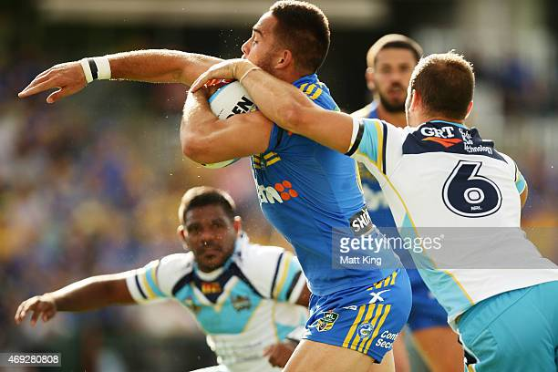 Corey Norman of the Eels is tackled during the round six NRL match between the Parramatta Eels and the Gold Coast Titans at Pirtek Stadium on April...