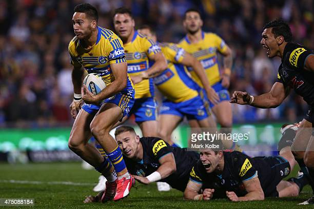 Corey Norman of the Eels makes a break during the round 12 NRL match between Penrith Panthers and the Parramatta Eels at Pepper Stadium on May 29...
