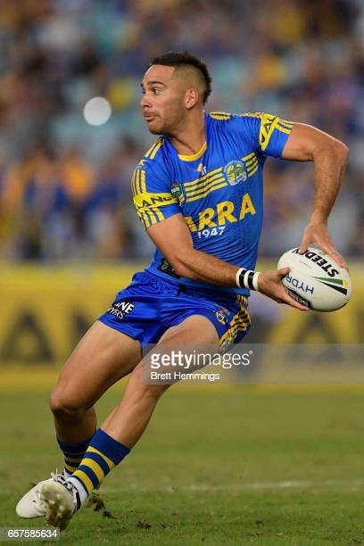 Corey Norman of the Eels passes the ball during the round four NRL match between the Parramatta Eels and the Cronulla Sharks at ANZ Stadium on March...