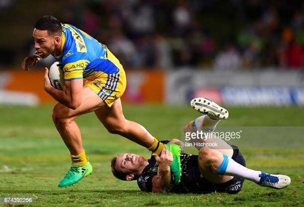 Corey Norman of the Eels skips out of a tackle of Michael Morgan of the Cowboys during the round nine NRL match between the North Queensland Cowboys...