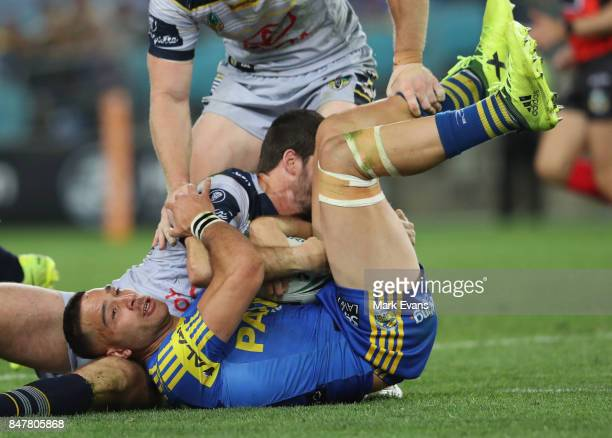 Corey Norman of the Eels tackled during the NRL Semi Final match between the Parramatta Eels and the North Queensland Cowboys at ANZ Stadium on...