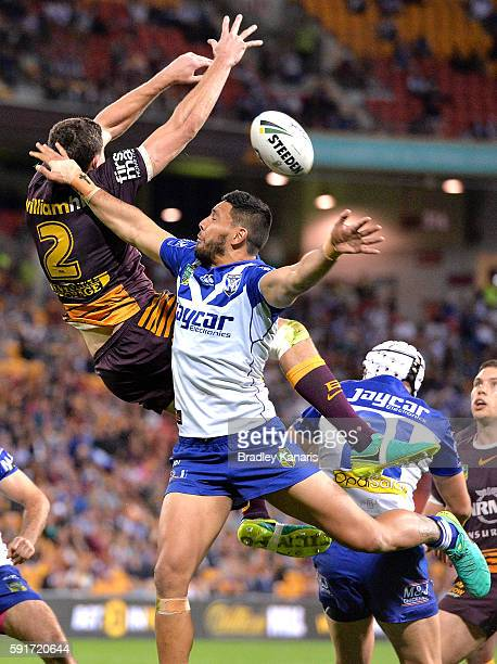 Corey Oates of the Broncos and Curtis Rona of the Bulldogs challenge for the ball during the round 24 NRL match between the Brisbane Broncos and the...