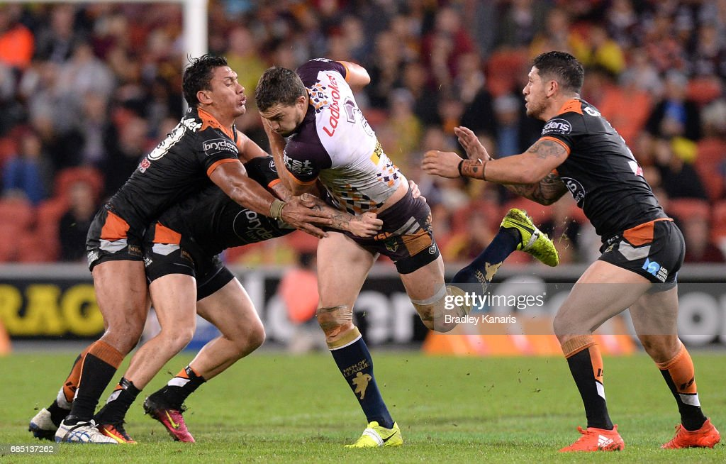 Corey Oates of the Broncos attempts to break through the defence during the round 11 NRL match between the Brisbane Broncos and the Wests Tigers at Suncorp Stadium on May 19, 2017 in Brisbane, Australia