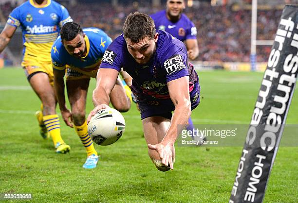 Corey Oates of the Broncos dives over to score a try during the round 23 NRL match between the Brisbane Broncos and the Parramatta Eels at Suncorp...