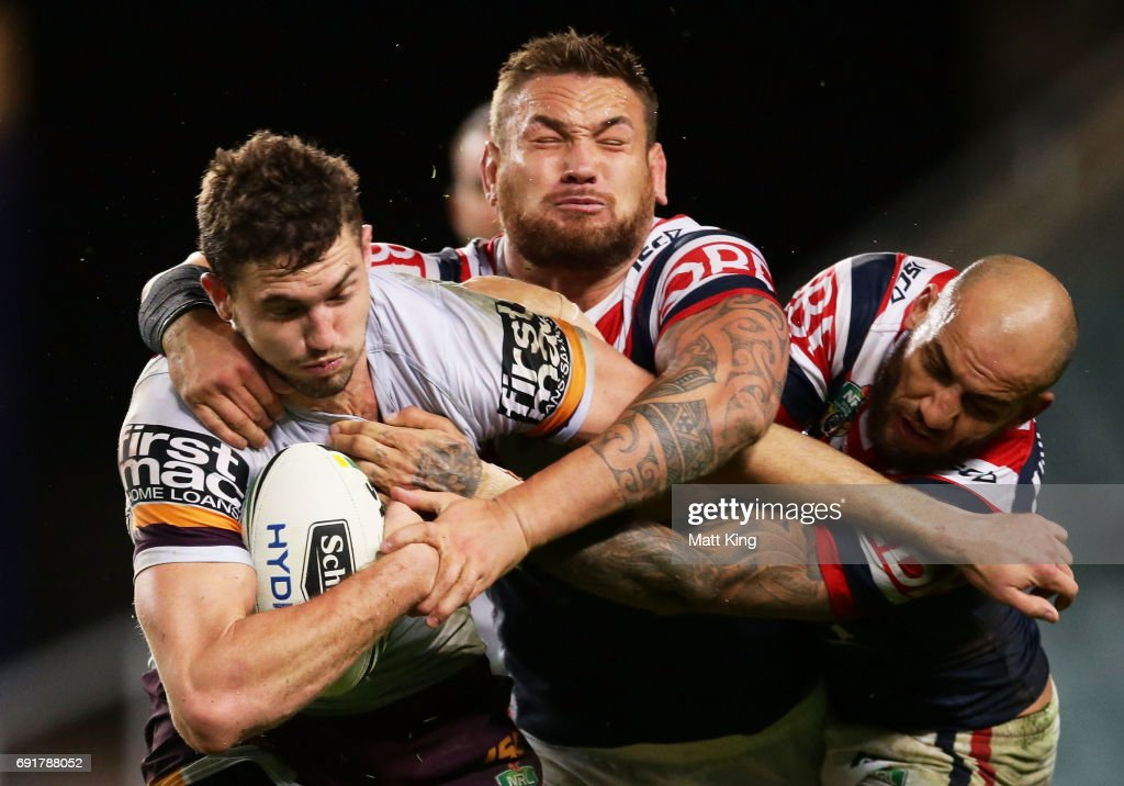 Corey Oates of the Broncos is tackled by Jared Waerea-Hargreaves (L) and Blake Ferguson (R) of the Roosters during the round 13 NRL match between the Sydney Roosters and the Brisbane Broncos at Allianz Stadium on June 3, 2017 in Sydney, Australia.