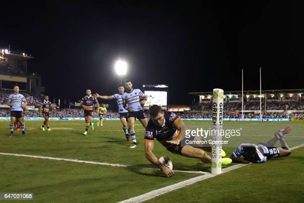 Corey Oates of the Broncos scores a try during the round one NRL match between the Cronulla Sharks and the Brisbane Broncos at Southern Cross Group...