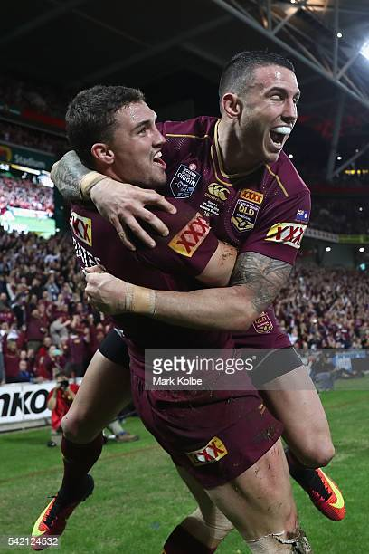 Corey Oates of the Maroons celebrates with his team mate Darius Boyd of the Maroons after scoring a try during game two of the State Of Origin series...