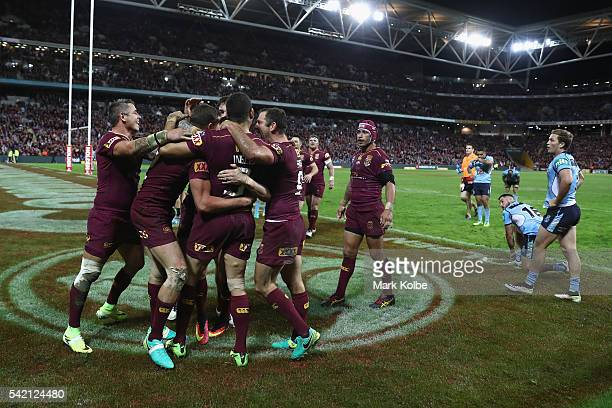 Corey Oates of the Maroons celebrates with his team mates after scoring a try during game two of the State Of Origin series between the Queensland...