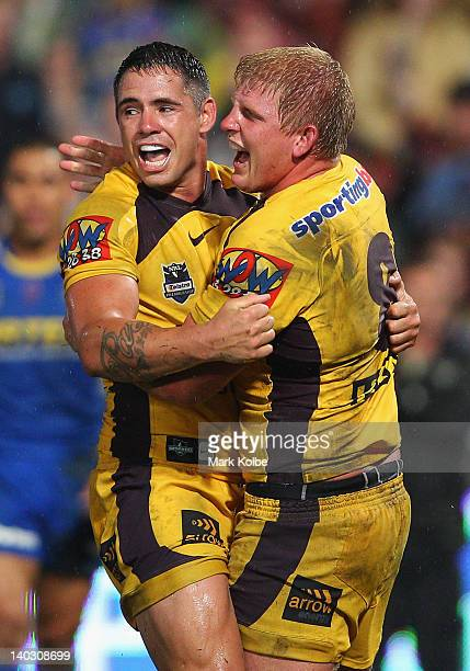 Corey Parker and Ben Hannant of the Broncos celebrate after Hannant scored a try during the round one NRL match between the Parramatta Eels and the...