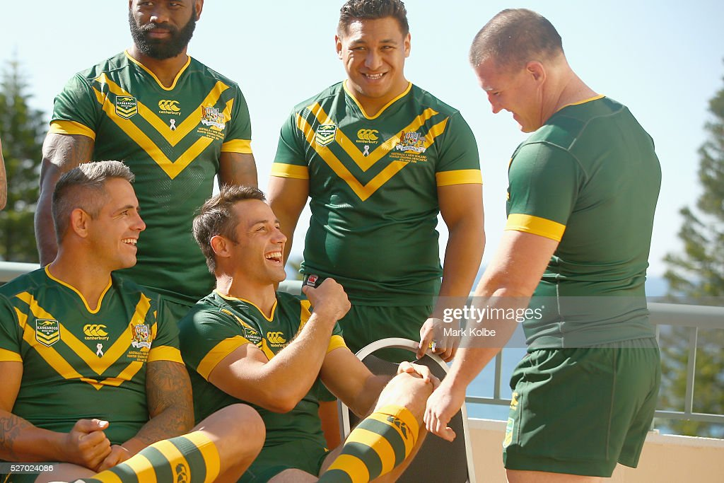Corey Parker and Cooper Cronk share a joke with Paul Gallen as they ste up for the team photo during the Australia Kangaroos Test team photo session at Crowne Plaza Coogee on May 2, 2016 in Sydney, Australia.