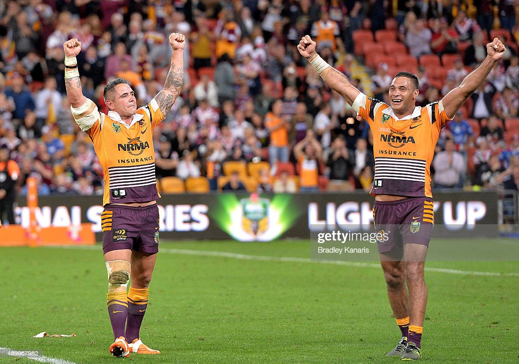 Corey Parker and Justin Hodges of the Broncos celebrate victory after the NRL First Preliminary Final match between the Brisbane Broncos and the Sydney Roosters at Suncorp Stadium on September 25, 2015 in Brisbane, Australia.