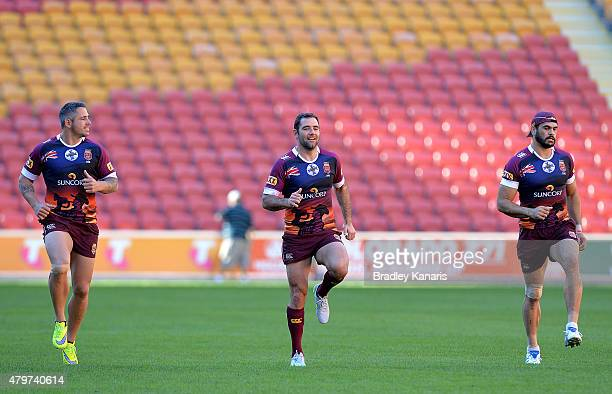 Corey Parker Cameron Smith and Greg Inglis run during the Queensland Maroons State of Origin captain's run at Suncorp Stadium on July 7 2015 in...
