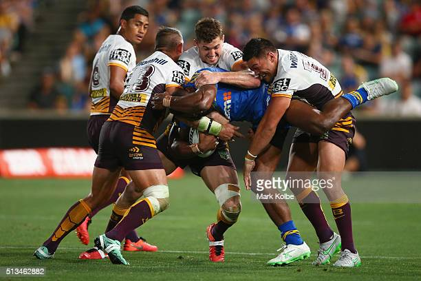 Corey Parker Corey Oates and Alex Glenn of the Broncos tackle Semi Radradra of the Eels during the round one NRL match between the Parramatta Eels...