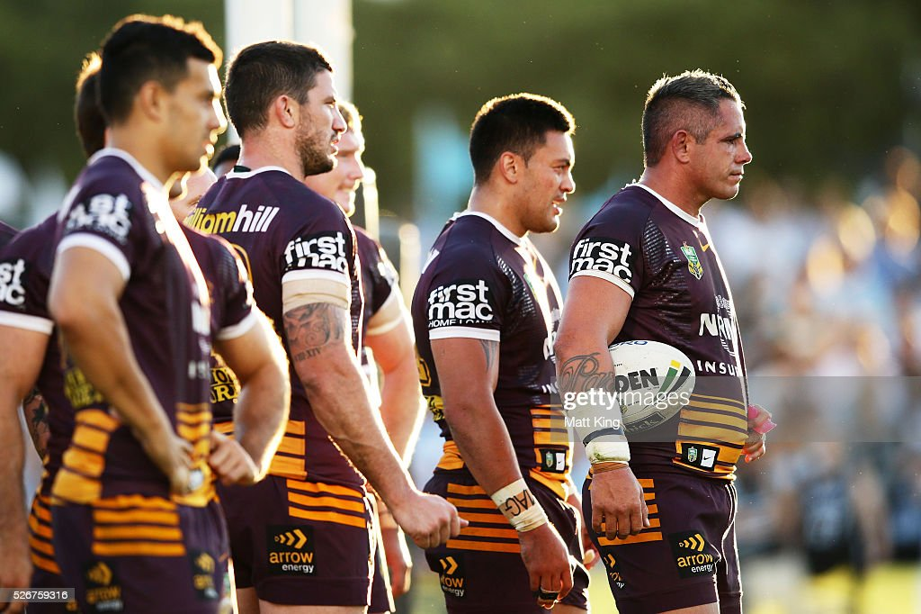 Corey Parker (R) of the Broncos and team mates look dejected after a Sharks try during the round nine NRL match between the Cronulla Sharks and the Brisbane Broncos at Southern Cross Group Stadium on May 1, 2016 in Sydney, Australia.
