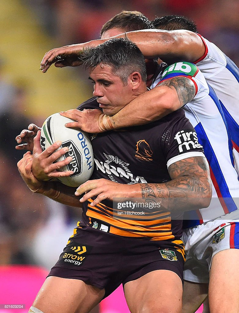 Corey Parker of the Broncos is tackled by Sam Mataora and Tyler Randell of the Knights during the round seven NRL match between the Brisbane Broncos and the Newcastle Knights at Suncorp Stadium on April 16, 2016 in Brisbane, Australia.