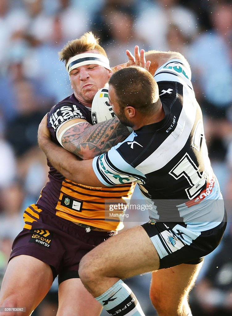 Corey Parker of the Broncos is tackled by Wade Graham of the Sharks during the round nine NRL match between the Cronulla Sharks and the Brisbane Broncos at Southern Cross Group Stadium on May 1, 2016 in Sydney, Australia.
