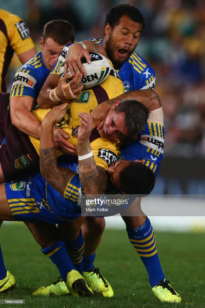 Corey Parker of the Broncos is tackled during the round nine NRL match between the Parramatta Eels and the Brisbane Broncos at Parramatta Stadium on May 11, 2013 in Sydney, Australia.