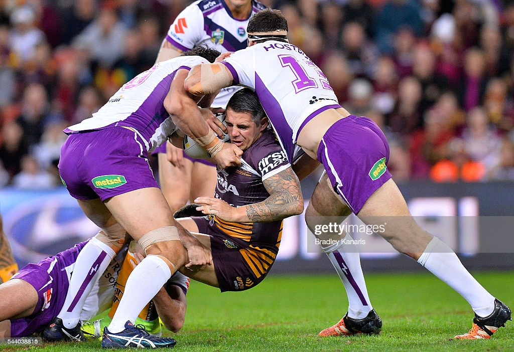 <a gi-track='captionPersonalityLinkClicked' href=/galleries/search?phrase=Corey+Parker+-+Rugby+Player&family=editorial&specificpeople=11188763 ng-click='$event.stopPropagation()'>Corey Parker</a> of the Broncos is wrapped up by the defence during the round 17 NRL match between the Brisbane Broncos and the Melbourne Storm at Suncorp Stadium on July 1, 2016 in Brisbane, Australia.