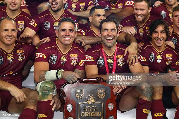 Corey Parker of the Maroons and Cameron Smith of the Maroons celebrate winning the series following game three of the State Of Origin series between...