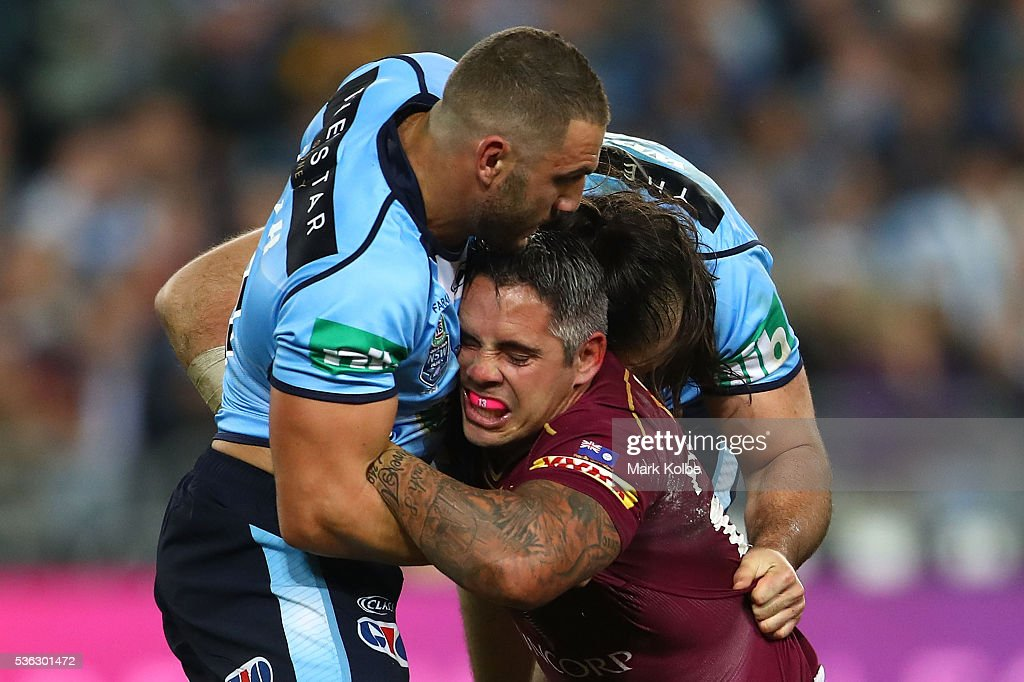 Corey Parker of the Maroons is tackled during game one of the State Of Origin series between the New South Wales Blues and the Queensland Maroons at ANZ Stadium on June 1, 2016 in Sydney, Australia.