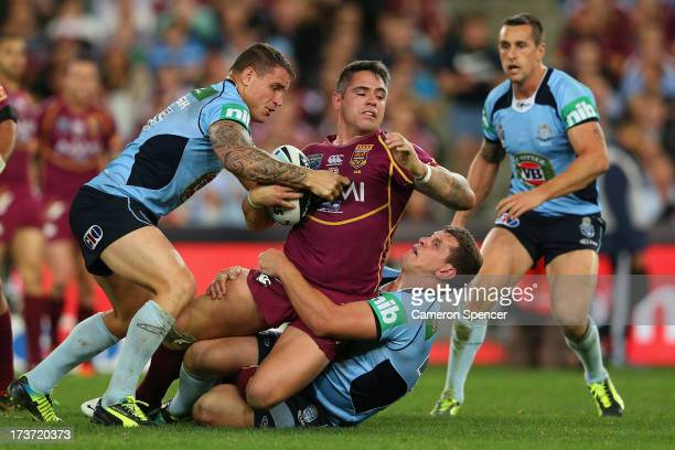 Corey Parker of the Maroons is tackled during game three of the ARL State of Origin series between the New South Wales Blues and the Queensland...