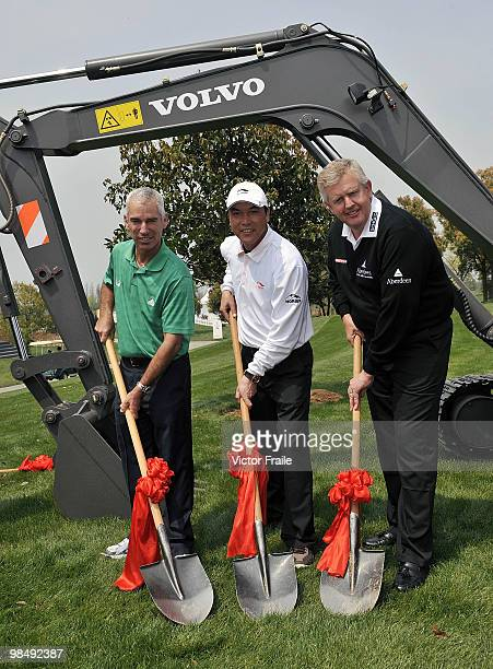 Corey Pavin of USA Zhang Lianwei of China and Colin Montgomerie of Scotland pose for the media after planting a tree during the Round Two of the...