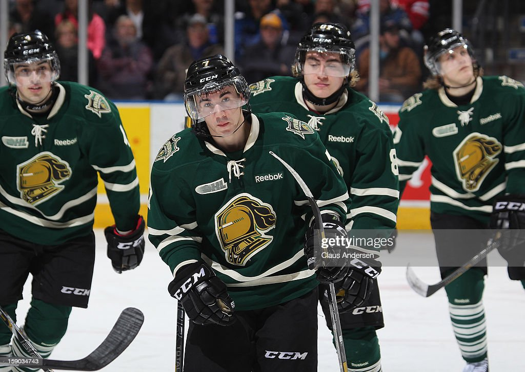 Corey Pawley #7 of the London Knights skates back to the bench after scoring in an OHL game against the Saginaw Spirit on January 4, 2013 at the Budweiser Gardens in London, Canada. The Knights defeated the Spirit 8-2.