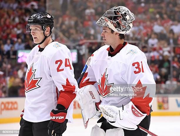 Corey Perry and Carey Price of Team Canada between plays against Team USA during the World Cup of Hockey 2016 at Air Canada Centre on September 20...