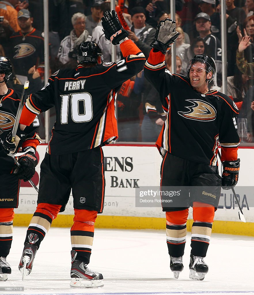 <a gi-track='captionPersonalityLinkClicked' href=/galleries/search?phrase=Corey+Perry&family=editorial&specificpeople=213864 ng-click='$event.stopPropagation()'>Corey Perry</a> #10 and <a gi-track='captionPersonalityLinkClicked' href=/galleries/search?phrase=Francois+Beauchemin&family=editorial&specificpeople=604125 ng-click='$event.stopPropagation()'>Francois Beauchemin</a> #23 of the Anaheim Ducks high-five each other after Perry's winning goal in a shootout against the Los Angeles Kings on April 7, 2013 at Honda Center in Anaheim, California.