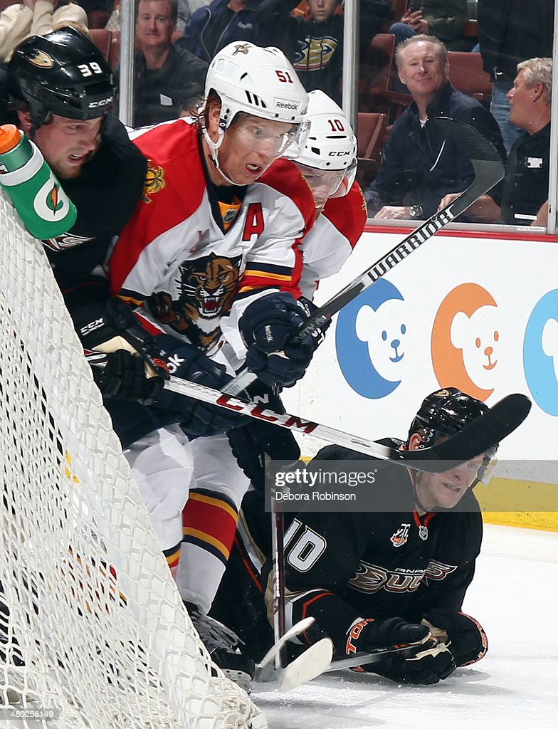 Corey Perry and Matt Beleskey of the Anaheim Ducks battle for position against Brian Campbell and Joey Crabb of the Florida Panthers on March 23 2014...