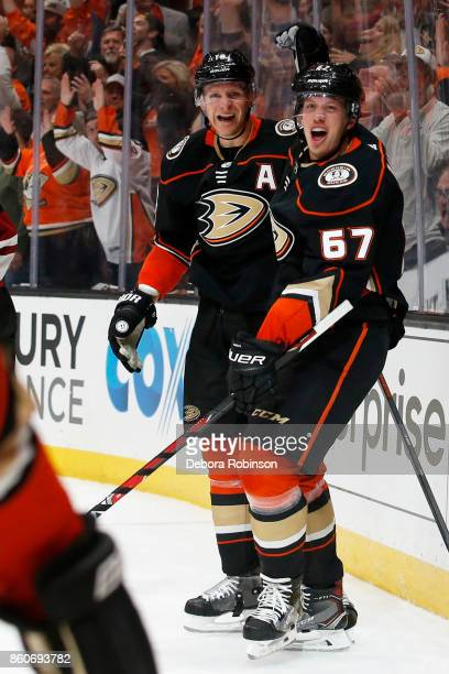 Corey Perry and Rickard Rakell of the Anaheim Ducks celebrate a goal during the game against the Arizona Coyotes on October 5 2017 at Honda Center in...