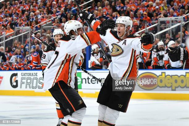 Corey Perry and Rickard Rakell of the Anaheim Ducks celebrate after a goal in Game Four of the Western Conference Second Round during the 2017 NHL...