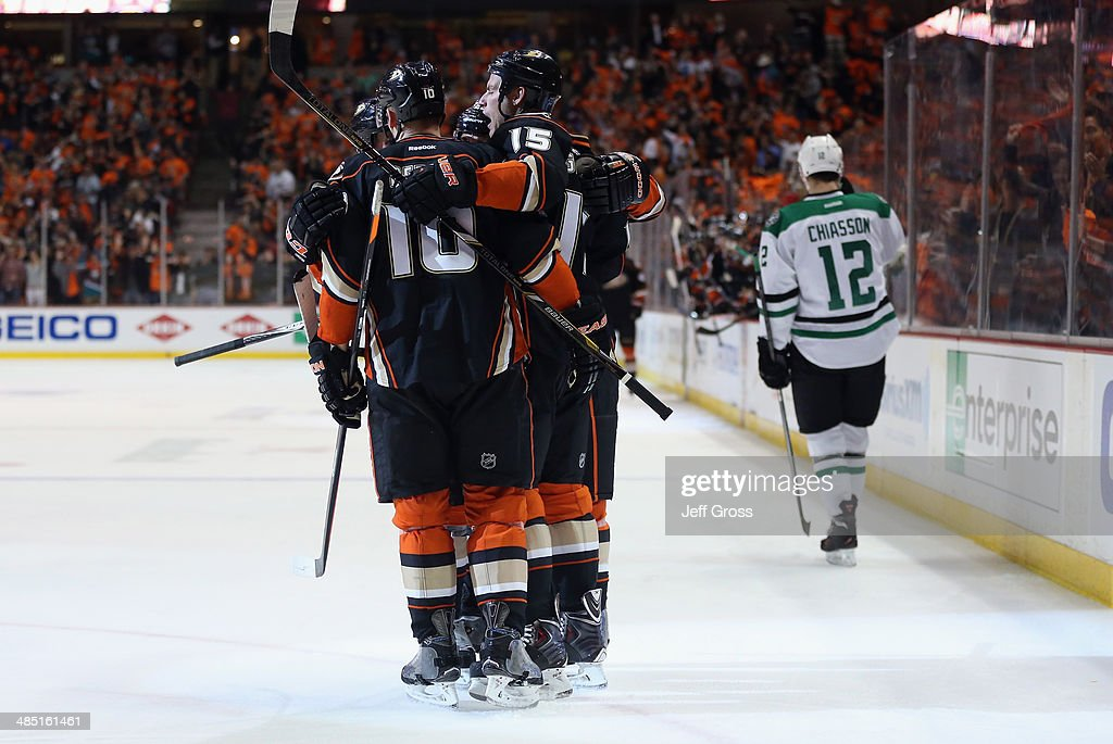 Corey Perry #10 and Ryan Getzlaf #15 of the Anaheim Ducks celebrate Getzlaf's first period goal, as Alex Chiasson #12 of the Dallas Stars skates to the bench in Game One of the First Round of the 2014 NHL Stanley Cup Playoffs at Honda Center on April 16, 2014 in Anaheim, California.