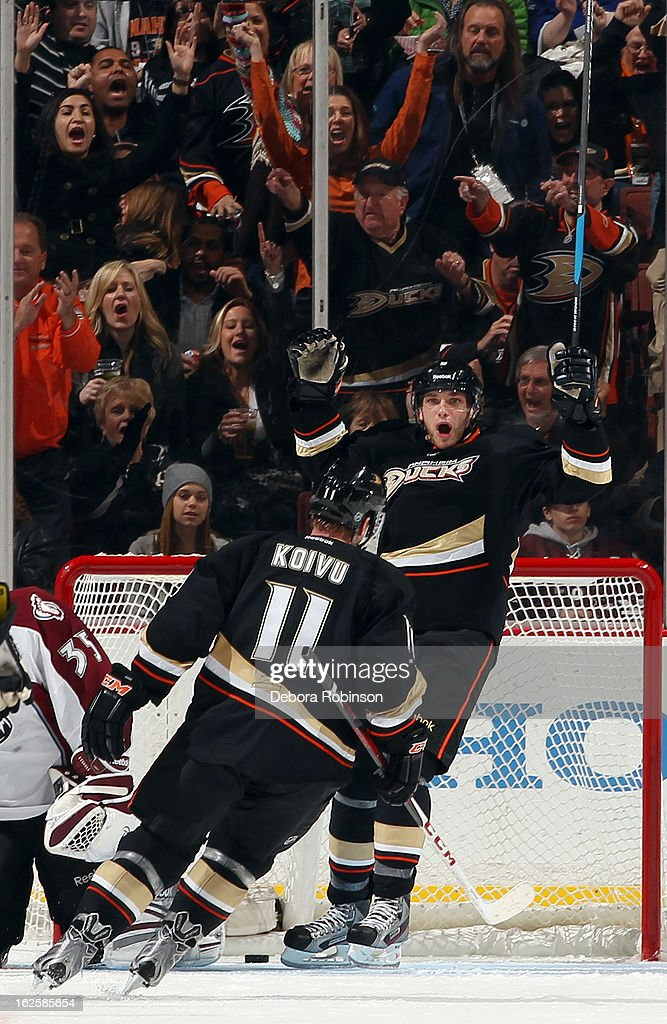 Corey Perry #10 and Saku Koivu #11 of the Anaheim Ducks celebrate a goal scored during the second period of the game against the Colorado Avalanche on February 24, 2013 at Honda Center in Anaheim, California.