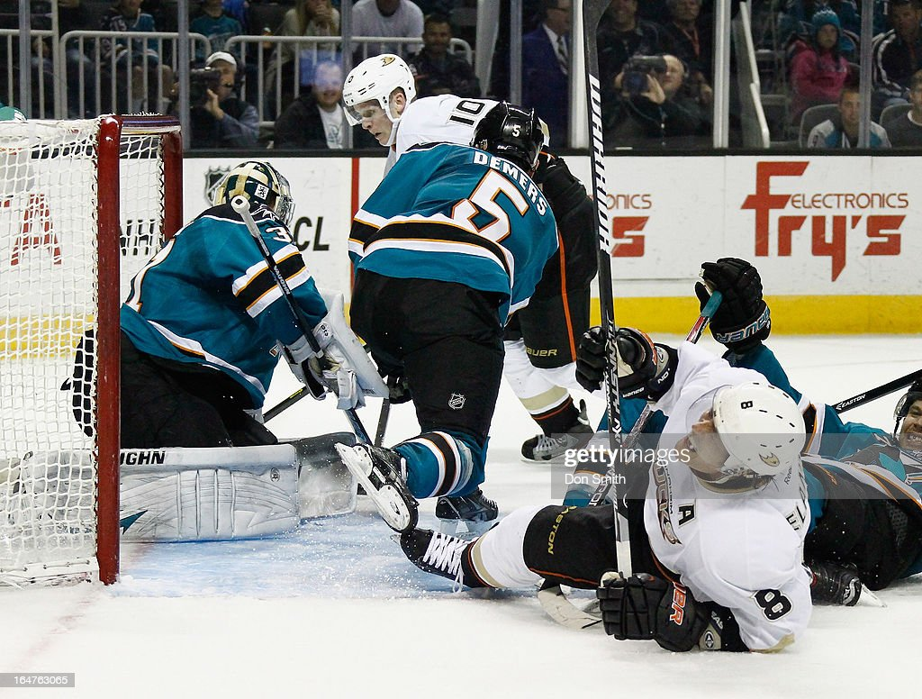 Corey Perry #10 and Teemu Selanne #8 of the Anaheim Ducks surround the net against Antti Niemi #31 and Jason Demers #5 of the San Jose Sharks during an NHL game on March 27, 2013 at HP Pavilion in San Jose, California.