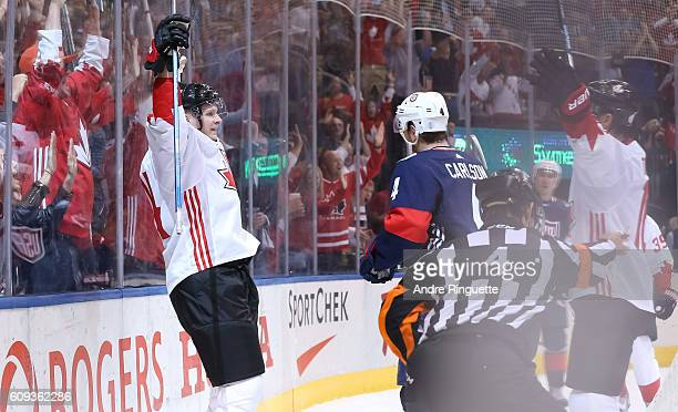 Corey Perry celebrates with Jonathan Toews of Team Canada after scoring a first period goal on Team USA during the World Cup of Hockey 2016 at Air...
