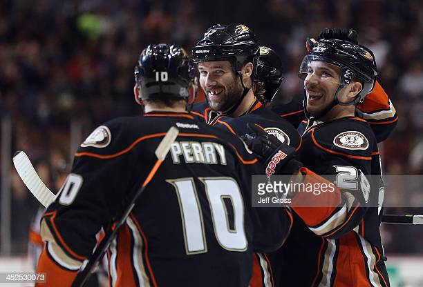 Corey Perry Dustin Penner and Mark Fistric of the Anaheim Ducks celebrate Penner's third period goal against the Calgary Flames at Honda Center on...