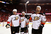Corey Perry Francois Beauchemin and Ryan Getzlaf of the Anaheim Ducks react after fans threw a drink on them after their goal against the Calgary...