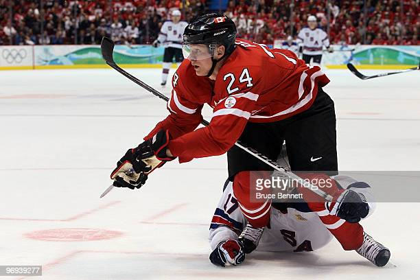 Corey Perry of Canada battles with Ryan Kesler of the United States during the ice hockey men's preliminary game between Canada and USA on day 10 of...
