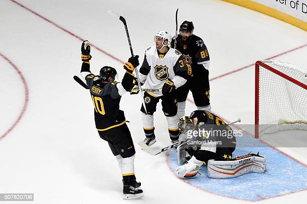 Corey Perry of the Anaheim Ducks and Brent Burns of the San Jose Sharks celebrate after John Gibson of the Anaheim Ducks makes a save during the 2016...
