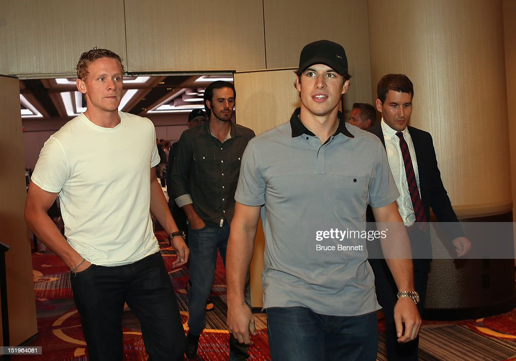 Corey Perry of the Anaheim Ducks and Sidney Crosby of the Pittsburgh Penguins arrive for the NHLPA press conference at Marriott Marquis Times Square on September 13, 2012 in New York City.