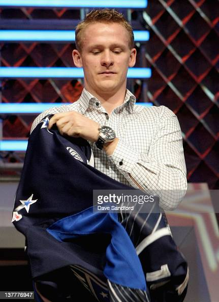 corey perry of the anaheim ducks and team charra puts on his jersey
