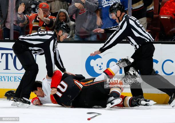 Corey Perry of the Anaheim Ducks and Travis Hamonic of the Calgary Flames battle after the whistle during the game on October 9 2017 at Honda Center...