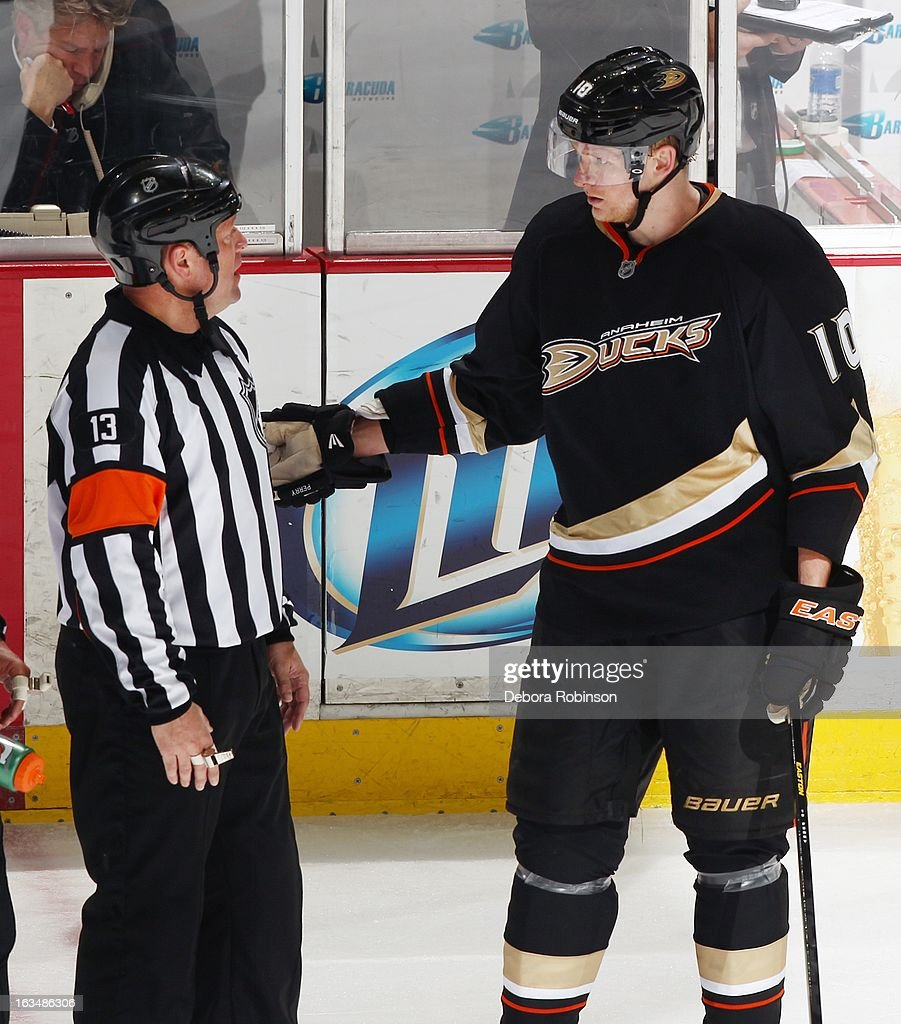 Corey Perry #10 of the Anaheim Ducks argues with referee Dan O'Halloran #13 against the St. Louis Blues on March 10, 2013 at Honda Center in Anaheim, California.