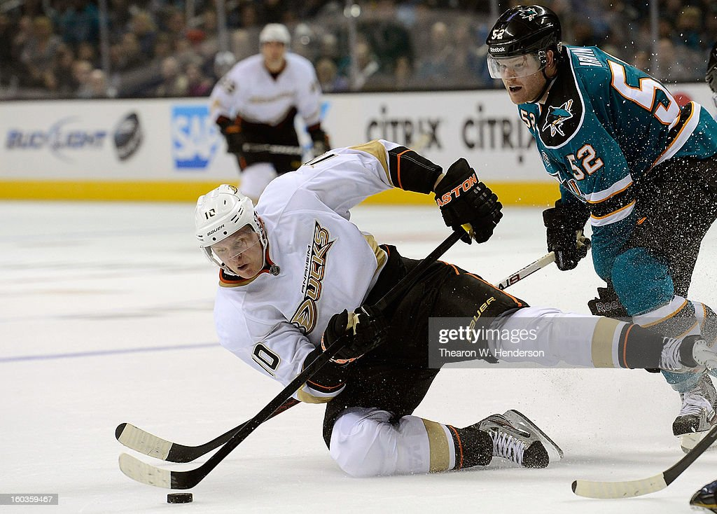 <a gi-track='captionPersonalityLinkClicked' href=/galleries/search?phrase=Corey+Perry&family=editorial&specificpeople=213864 ng-click='$event.stopPropagation()'>Corey Perry</a> #10 of the Anaheim Ducks attempting to maintain control of the puck gets checked to the ice by Matt Irwin #52 of the San Jose Shark in the third period at HP Pavilion on January 29, 2013 in San Jose, California. The Sharks won the game in an overtime shoot-out.