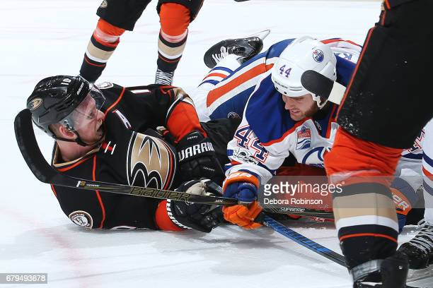 Corey Perry of the Anaheim Ducks battles against Zack Kassian of the Edmonton Oilers in Game Five of the Western Conference Second Round during the...