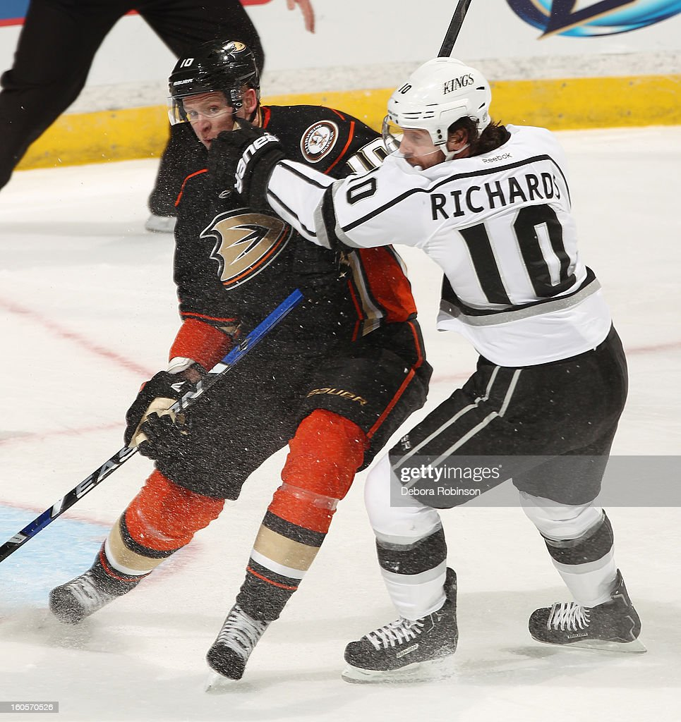 Corey Perry #10 of the Anaheim Ducks battles for position against Mike Richards #10 of the Los Angeles Kings on February 2, 2013 at Honda Center in Anaheim, California.