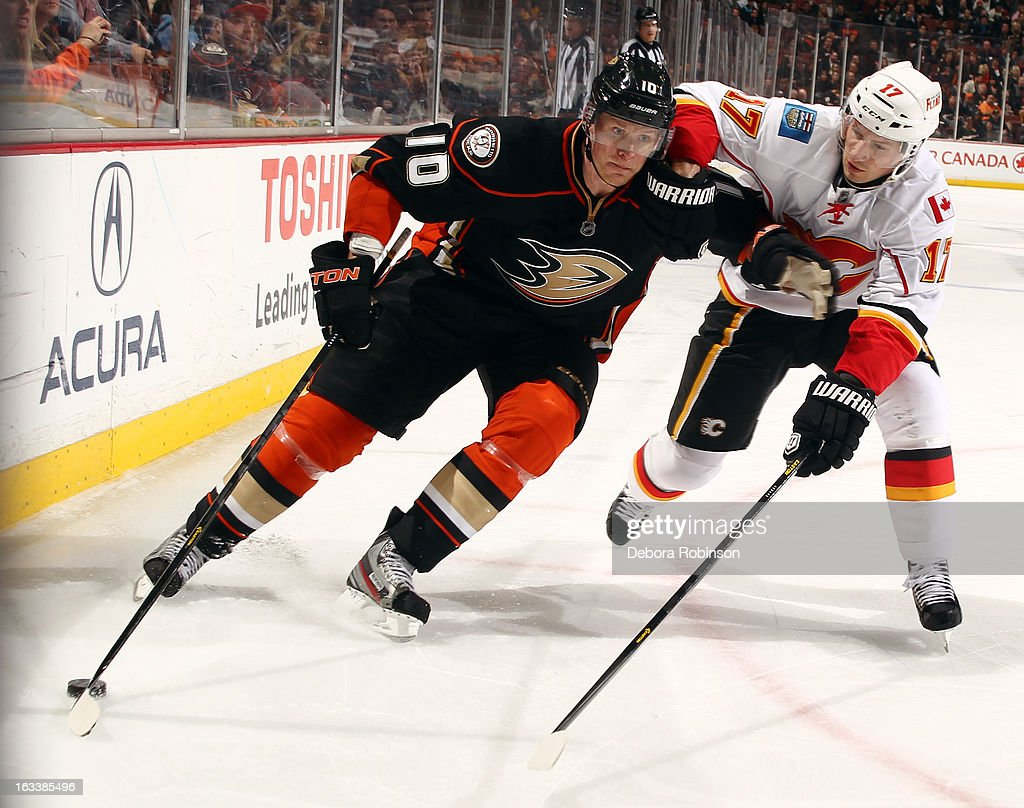 <a gi-track='captionPersonalityLinkClicked' href=/galleries/search?phrase=Corey+Perry&family=editorial&specificpeople=213864 ng-click='$event.stopPropagation()'>Corey Perry</a> #10 of the Anaheim Ducks battles for the puck against <a gi-track='captionPersonalityLinkClicked' href=/galleries/search?phrase=Blake+Comeau&family=editorial&specificpeople=879782 ng-click='$event.stopPropagation()'>Blake Comeau</a> #17 of the Calgary Flames on March 8, 2013 at Honda Center in Anaheim, California.