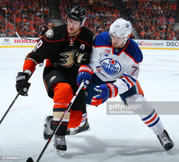 Corey Perry of the Anaheim Ducks battles for the puck against Oscar Klefbom of the Edmonton Oilers in Game One of the Western Conference Second Round...